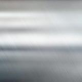 De achtergrond van de metaaltextuur Geborsteld Staal Stock Afbeeldingen