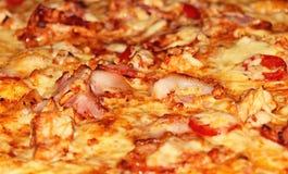 De achtergrond van de pizza Stock Afbeeldingen