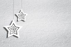 De achtergrond van de sneeuwtextuur met stervormen Stock Fotografie