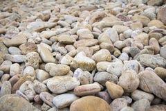 De achtergrond van de strandsteen Stock Foto