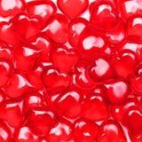 De Achtergrond van de valentijnskaartendag. Glas Rode Harten Stock Foto's