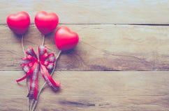 De achtergrond van de valentijnskaartendag met drie harten voor liefde Royalty-vrije Stock Foto's