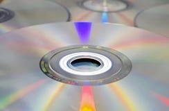 De achtergrond van DVD en CD. stock afbeeldingen