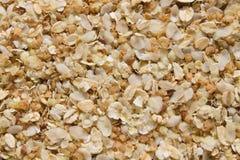 De achtergrond van een mengsel van rijst, haver, boekweit schilfert en lijnzaad af stock afbeeldingen