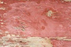 De achtergrond van een oude houten raad is geschilderd met rode verf, die beklom stock fotografie