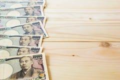 De Achtergrond van geldyen banknote on vintage wooden Royalty-vrije Stock Fotografie