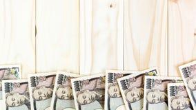 De Achtergrond van geldyen banknote on vintage wooden Royalty-vrije Stock Foto's