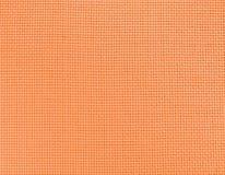 De achtergrond van geweven oranje natuurlijke stof stock foto
