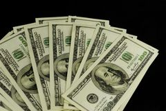 De achtergrond van heel wat bankbiljetten van geld int 100 dollars royalty-vrije stock foto's