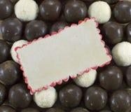 De achtergrond van het chocoladesuikergoed met kaart Royalty-vrije Stock Afbeeldingen