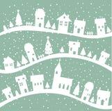 De achtergrond van het dorpsKerstmis van de winter Stock Afbeeldingen