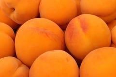 De achtergrond van het fruit Rijpe perziken Stock Afbeelding