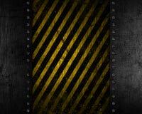 De achtergrond van het Grungemetaal met gele en zwarte verontruste textuur Stock Foto