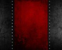 De achtergrond van het Grungemetaal met rode verontruste textuur Royalty-vrije Stock Afbeeldingen