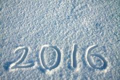 De achtergrond van het nieuwjaar en van Kerstmis van sneeuw tekst op sneeuw 2016 Royalty-vrije Stock Foto's