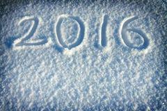 De achtergrond van het nieuwjaar en van Kerstmis van sneeuw tekst op sneeuw 2016 Stock Afbeeldingen