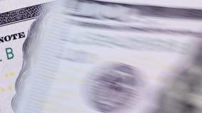 De achtergrond van het roteren van de nieuwe honderd dollarsrekeningen stock videobeelden