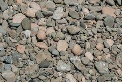 De Achtergrond van het steenstrand Stock Foto's