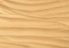 De achtergrond van het strandzand Stock Afbeelding