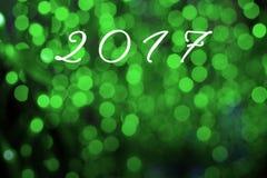 De achtergrond van het woord 2017 Gelukkige Nieuwjaar op groene toon bokeh Royalty-vrije Stock Foto's