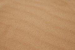De achtergrond van het zand Stock Foto's