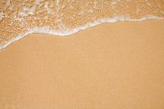 De achtergrond van het zand en van de golf stock fotografie