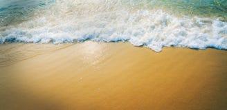 De achtergrond van het zandstrand Stock Foto's