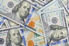 De achtergrond van honderd dollarsbankbiljetten Stock Afbeeldingen