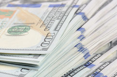 De achtergrond van honderd dollarsbankbiljetten Royalty-vrije Stock Afbeeldingen