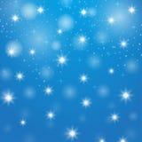 De achtergrond van Kerstmis Glanzende sterren Nieuw jaarbehang Royalty-vrije Stock Afbeeldingen