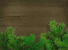 De achtergrond van Kerstmis Groene takken van sparren op donkere houten achtergrond Plaats voor tekst Royalty-vrije Stock Afbeeldingen