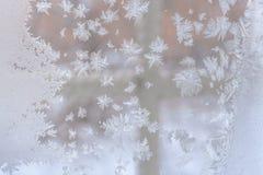De achtergrond van Kerstmis Ijzig patroon in de vorm van sneeuwvlokken o Royalty-vrije Stock Fotografie
