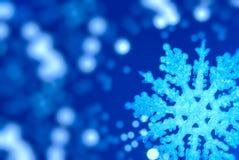 De achtergrond van Kerstmis met een grote sneeuwvlok stock afbeelding