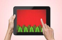 De achtergrond van Kerstmis op tabletPC. Stock Afbeeldingen