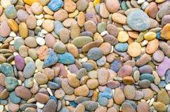 De achtergrond van kiezelsteenstenen Stock Afbeelding