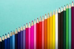 De achtergrond van kleurenpotloden Royalty-vrije Stock Afbeeldingen
