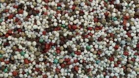 De achtergrond van de meststoffenomwenteling stock videobeelden