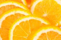 De achtergrond van sinaasappelen Stock Afbeeldingen