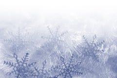 De achtergrond van sneeuwvlokken stock afbeeldingen