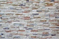 De achtergrond van steenbakstenen muur Stock Fotografie