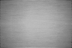 De achtergrond van de textuur Grijs geperforeerd metaalblad Staalplaat met gaten van een hartvorm royalty-vrije stock afbeeldingen