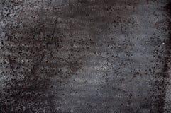 De achtergrond van de textuur Zwart ruberoidmateriaal met holten stock afbeeldingen