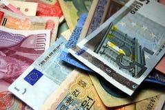 De Achtergrond van Vreemde valutabankbiljetten Stock Foto
