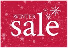 De Achtergrond van de de winterverkoop in rood met grote witte teksten en sneeuwvlokken Stock Foto's