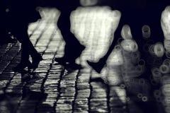 De achtergrondbenen silhouetteert mensen stock afbeelding