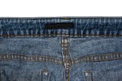De achterkant van jeans met plaats voor etiket op een witte achtergrond Royalty-vrije Stock Foto
