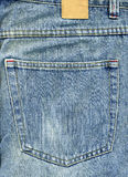 De achterzak van jeans met flard Royalty-vrije Stock Afbeeldingen