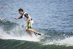 De Actie van Shortboard van mensen - Javier Julio Stock Foto