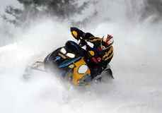 De actieschot van de sneeuwscooter stock fotografie