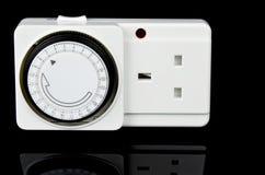 De Adapter van de leidingentijdopnemer Britse versiecontactdoos Stock Foto